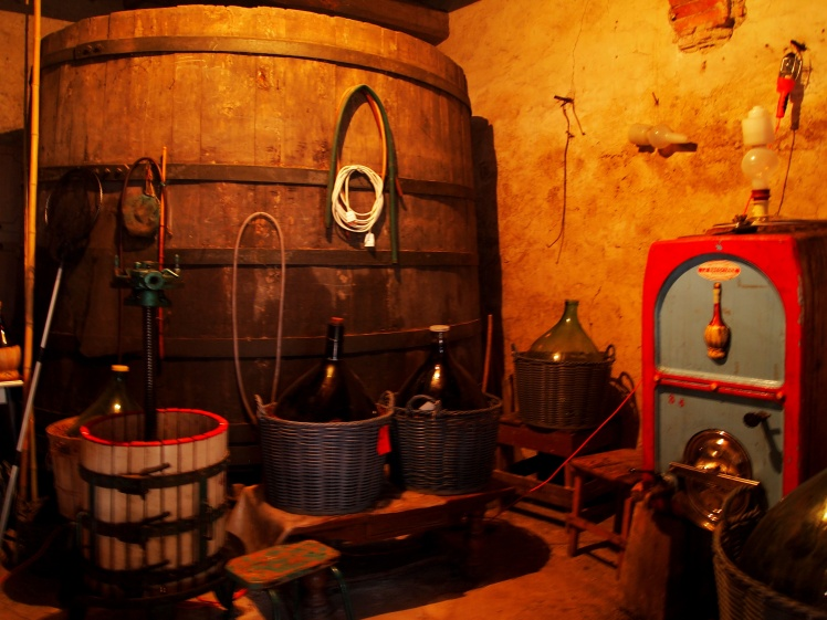 "Nonno (Italian for ""grandfather"") showed us where he and his family make their wine. The large barrel in the back is over 200 years old."