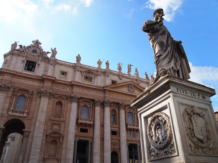 A statue of Saint Peter in front of the basilica that houses his remains.