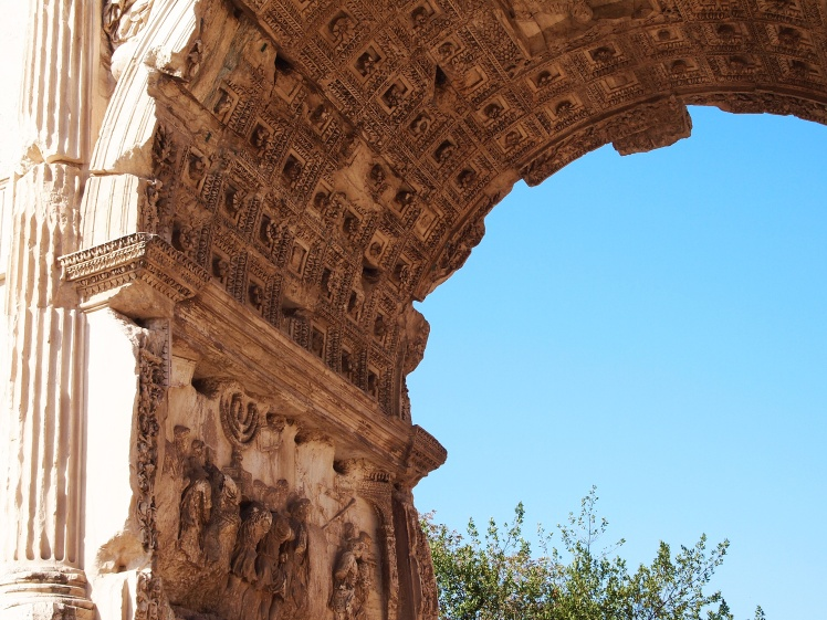 Inside the Arch of Titus, another Roman triumphal arch.
