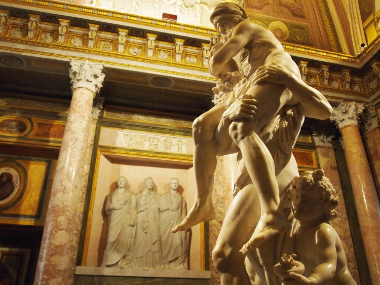 Aeneas carries his father, Anchises, and leads his son, Ascanius, out of Troy. They would go on to help in the foundation of Rome. Statue by Bernini.