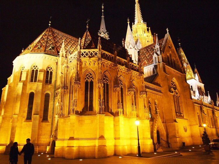 Mátyás-templom, or, Matthias Church. Its long and complicated history begins in 1015 and includes several reconstructions, a few coronations (and royal weddings), and even some time as a mosque.
