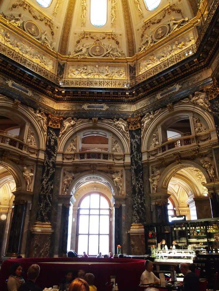 The main rotunda of the Kunsthistorisches Museum is home to a cafe, and is topped with an almost 200-foot-tall cupola.