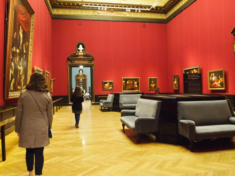 A room filled with paintings by famed artist Caravaggio and his contemporaries.