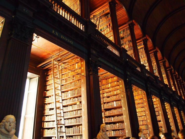 """The library's """"long room"""" is 213 feet long. It's home to over 200,000 of the oldest books in the school's collection."""